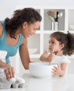 Mother and Daughter Baking Together --- Image by © Royalty-Free/Corbis