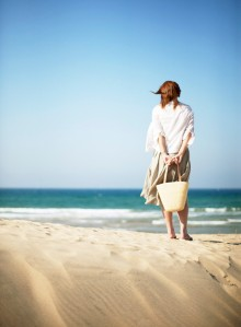 Woman on Beach Looking at Ocean --- Image by © Royalty-Free/Corbis
