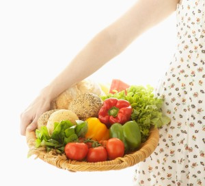 Woman with Basket of Food --- Image by © Royalty-Free/Corbis